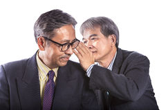Two asian senior business man gossip for business strategy isola Royalty Free Stock Images