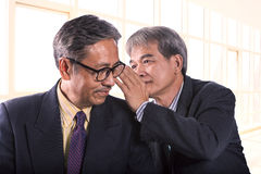 Two asian senior business man gossip for business strategy isola Stock Photos