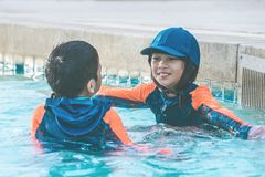 Two Asian in playing together in Water Aqua park pool stock photography