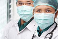 Two Asian surgeon posing to camera Royalty Free Stock Photo