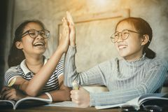 Two asian teenager happiness emotion celebrating education successful stock photography