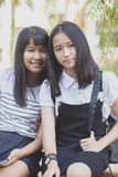 Two asian teenager smiling face happiness emotion vacation time royalty free stock photo