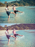 Two Asian Thai girls are kicking the sea along the beach coast o Stock Images