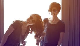 Two Asian woman friends having fun together royalty free stock photography