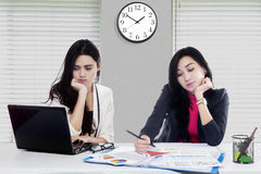 Two asian woman tired in office Stock Image