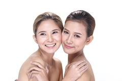Two Asian women with beautiful fashion make up wrapped hair. Open shoulder clean skin, studio lighting white background isolated Stock Photos