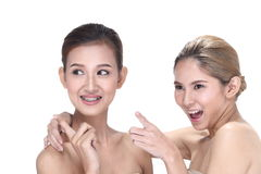 Two Asian women with beautiful fashion make up wrapped hair. Open shoulder clean skin, studio lighting white background isolated Stock Images
