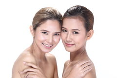 Two Asian women with beautiful fashion make up wrapped hair. Open shoulder clean skin, studio lighting white background isolated Royalty Free Stock Photo
