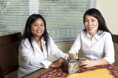 Two Asian Women drinking tea Stock Photos