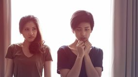 Two Asian women fight, bully, jealous friend and relationship problem. Two Asian women fight, bully, jealous friend and coworker relationship problem stock image
