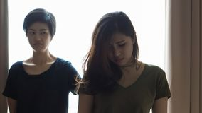 Two Asian women fight, bully, jealous friend and coworker relationship problem. Two Asian women fight, bully, jealous friend relationship problem stock image