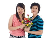 Two asian women with flowers Stock Photos