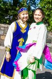 Two Asian Women in traditional clothes. This is a photograph of two Asian women dressed in full traditional clothes at the Annual Drums Along the Hudson in Royalty Free Stock Photography