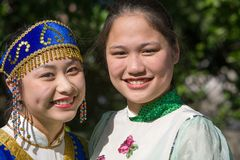Two Asian Women in traditional clothes. This is a photograph of two Asian women dressed in full traditional clothes at the Annual Drums Along the Hudson in Royalty Free Stock Images