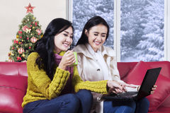 Two asian women use laptop at home Stock Photo
