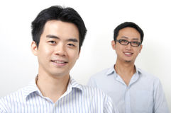Two Asian young executives Royalty Free Stock Image