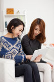 Two Asian young woman using tablet PC. Royalty Free Stock Photo