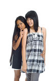 Two asians having a secret Stock Photography