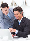 Two assertive colleagues working at a computer Royalty Free Stock Images