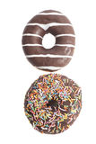 Two Assorted Donuts isolated on a white Royalty Free Stock Photos