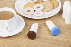 Two asthma powder inhalers laying on the breakfast table Royalty Free Stock Photo