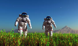 Two astronauts. On the green grass Stock Photos