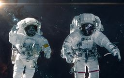 Two astronauts on background of nebulae and star clusters. Deep space landscape. Science fiction