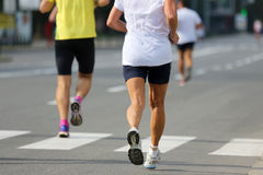 Two athlete runners at the marathon distance stock images