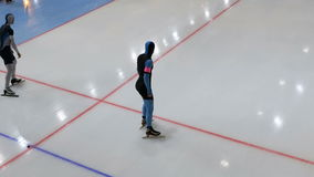 Two athlete speed skater start of sprint stock video footage