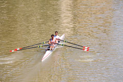 Two athletes in academic rowing training on the river Arno Royalty Free Stock Photo