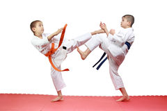 Two athletes are beating kicks on the mats Stock Photo