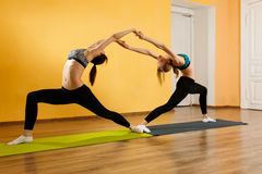 Two athletes doing stretching exercises. In gym Royalty Free Stock Images