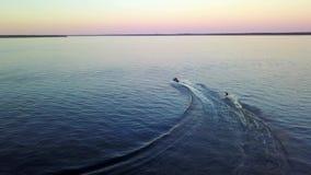 Two athletes jetski speed action at Jetski, waterskiing. Two athletes jetski speed action at jetski, waterskiing, drone camera stock footage