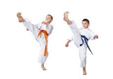 Two athletes in karategi beat kick Royalty Free Stock Photography