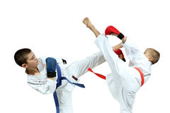 Two athletes in the linings are beating kicks Stock Photo