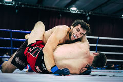 Two athletes MMA ground fighting Royalty Free Stock Photo