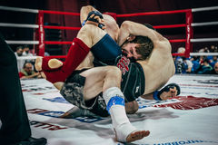 Two athletes MMA ground fighting Stock Photography