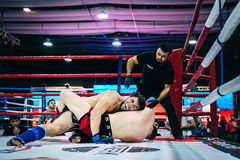 Two athletes MMA ground fighting Royalty Free Stock Image