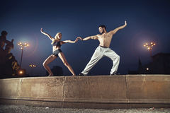 Two athletes practising in the night Royalty Free Stock Photos