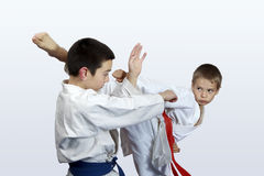 Two athletes with red and blue belt doing karate  strikes Royalty Free Stock Image
