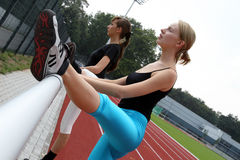 Two Athletes stretching. Two young girls stretching after jogging stock photo