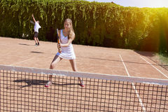 Two athletes on tennis court royalty free stock image