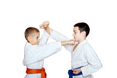 Two athletes train punch and protection block Royalty Free Stock Images