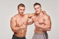 Two athletic men gesturing thumbs up Stock Photography