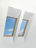 Two attic windows Stock Images