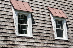 Two attic windows of house roof Royalty Free Stock Image
