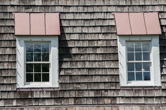Two attic windows of house roof Royalty Free Stock Photography