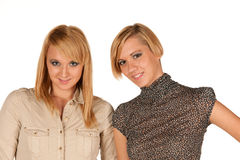 Two attractive blonde girls studio portrait Stock Photos