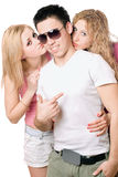Two attractive blonde kissing young man Stock Photography