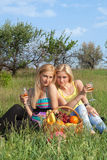 Two attractive blonde with wineglasses Stock Photos